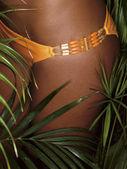 Photo of girl thighs in orange bikini — Stock Photo