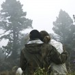 Couple looking at misty winter landscape — Stock Photo #10402452