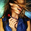 Stock Photo: Girl with red lollipop and hair in face