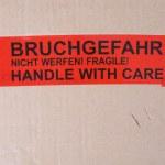 Fragile packet parcel — Stock Photo