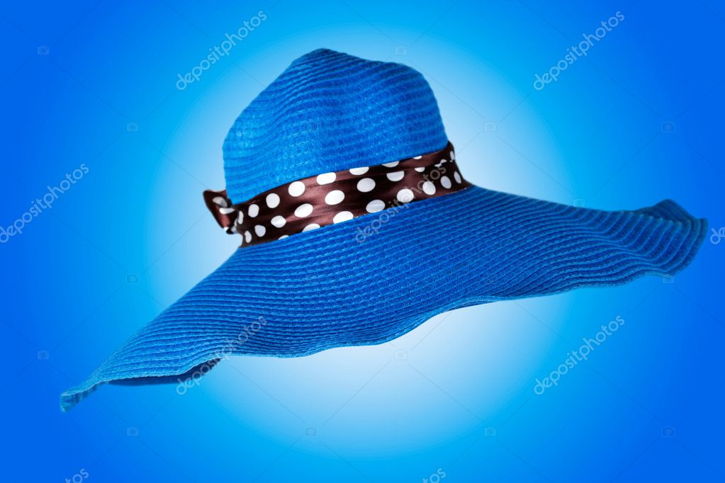 Blue big woman hat on a blue background — Stock Photo #10052303