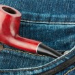 Smoking pipe in jeans — Stock Photo #10607819