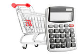 Calculator with a shopping cart — Stock Photo