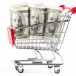 Shopping cart and dollars — Stock Photo