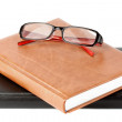 Books stack with eyeglass — Stock Photo #8310958