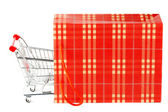 Shopping cart and paper bag — Stock Photo