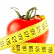 Tomatoes with measuring tape — Stock Photo