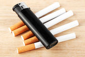 Stack of cigarette with the lighter — Stock Photo