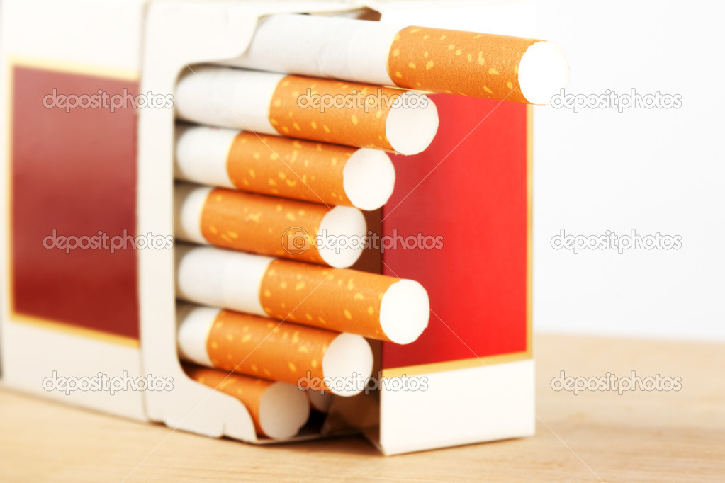 Several Cigarettes in pack on the breadboard  Stock Photo #8388523