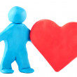 Plasticine man with plasticine heart - Stock Photo