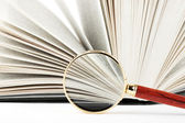 Magnifier and book — Stock Photo