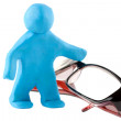 Plasticine mwith eyeglass — Stock Photo #8492591