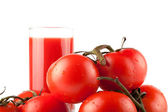 Stack of perfect tomatos with juice — Stock Photo