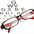 Reading glasses with eye chart - 图库照片
