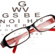 Reading glasses with eye chart — Lizenzfreies Foto