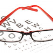 Reading glasses with eye chart - Stock fotografie