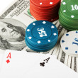 Casino colorful chips and dollars — Stock Photo