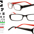 Reading glasses with eye chart - Foto Stock