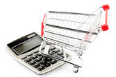 Calculator with a shopping cart. — Foto de Stock