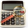 Royalty-Free Stock Photo: Calculator with a magnifying