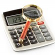 Calculator with a magnifying — Stock Photo