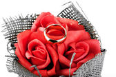 Wedding ring on the roses — Stock Photo