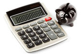 Calculator and piggy bank — Stock Photo