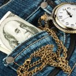 Money and watch in a jeans — Stock Photo