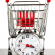 Shopping cart and alarm clock - Stok fotoraf