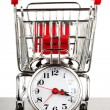Shopping cart and alarm clock - Photo