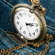 Stock Photo: Watch in pocket of jeans