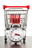 Shopping cart and alarm clock — Stok fotoğraf