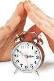 Alarm clock with hands — Stock Photo