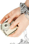 Hands with dollars in chain — Stock Photo
