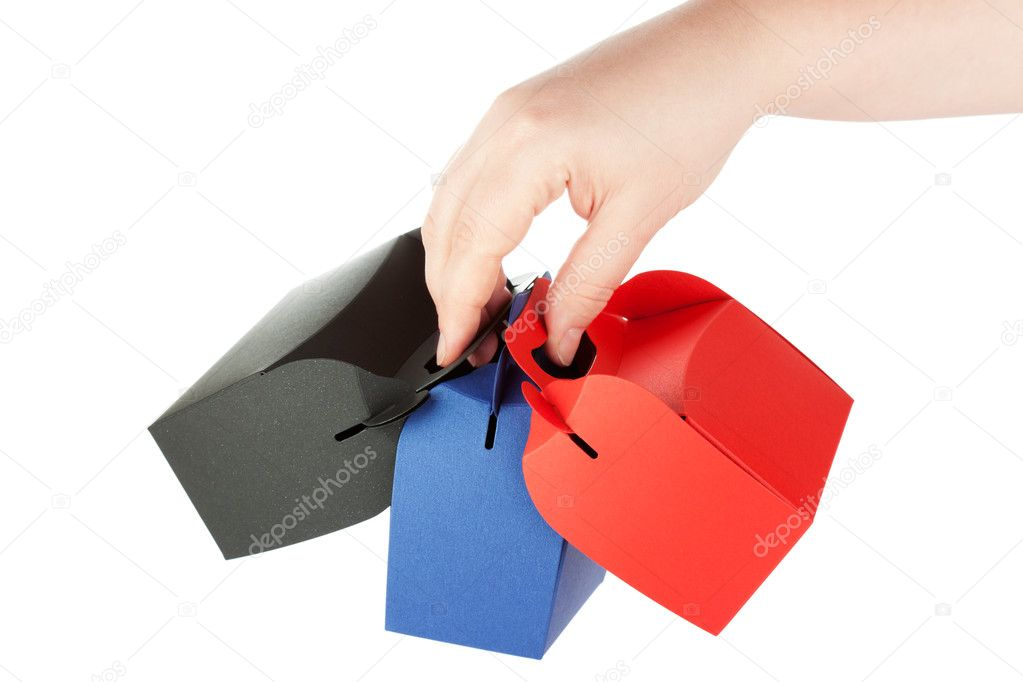 Gift Shopping red, black and blue Boxes in hands on the white background — Stock Photo #9569210