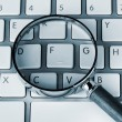 Magnifying on keyboard — Stock Photo #9647604