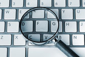 Magnifying on a keyboard — Stock Photo
