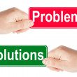 Problems and Solutions traffic sign in the hand — Stock Photo #9931952