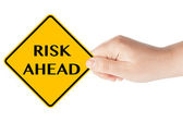 Risk Ahead sign with hand — Stock Photo