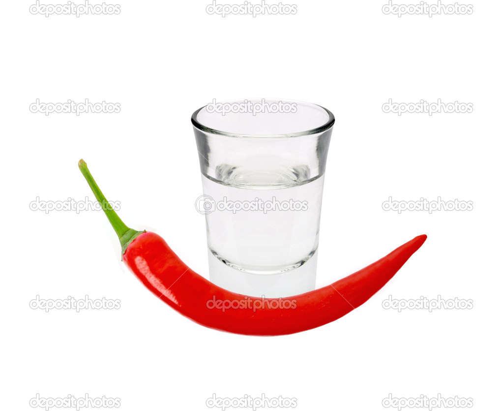 Glass of vodka and red chilli peppers isolated on white — Stock Photo #10391194