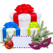 Christmas gifts with post card and branch firtree isolated on wh — Stock Photo
