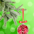 Christmas ball on the tree over green background — Stock Photo
