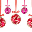 Red and Pink Christmas balls with bows on white background — Stock Photo