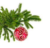 Christmas tree branch with red decorate ball isolated on white — Stock Photo