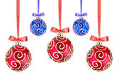 Red and Blue Christmas balls with bows on white background — Stockfoto