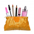 Beautiful golden makeup bag and cosmetics isolated on white — Stock Photo