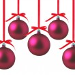 图库照片: Red Christmas balls with bows on white background