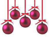 Röda julgranskulor med rosetter på vit bakgrund — Stockfoto