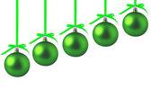 白い背景の上の弓と緑のクリスマス ボール — ストック写真