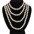 Stockfoto: Pearl necklace on black mannequin isolated on white background